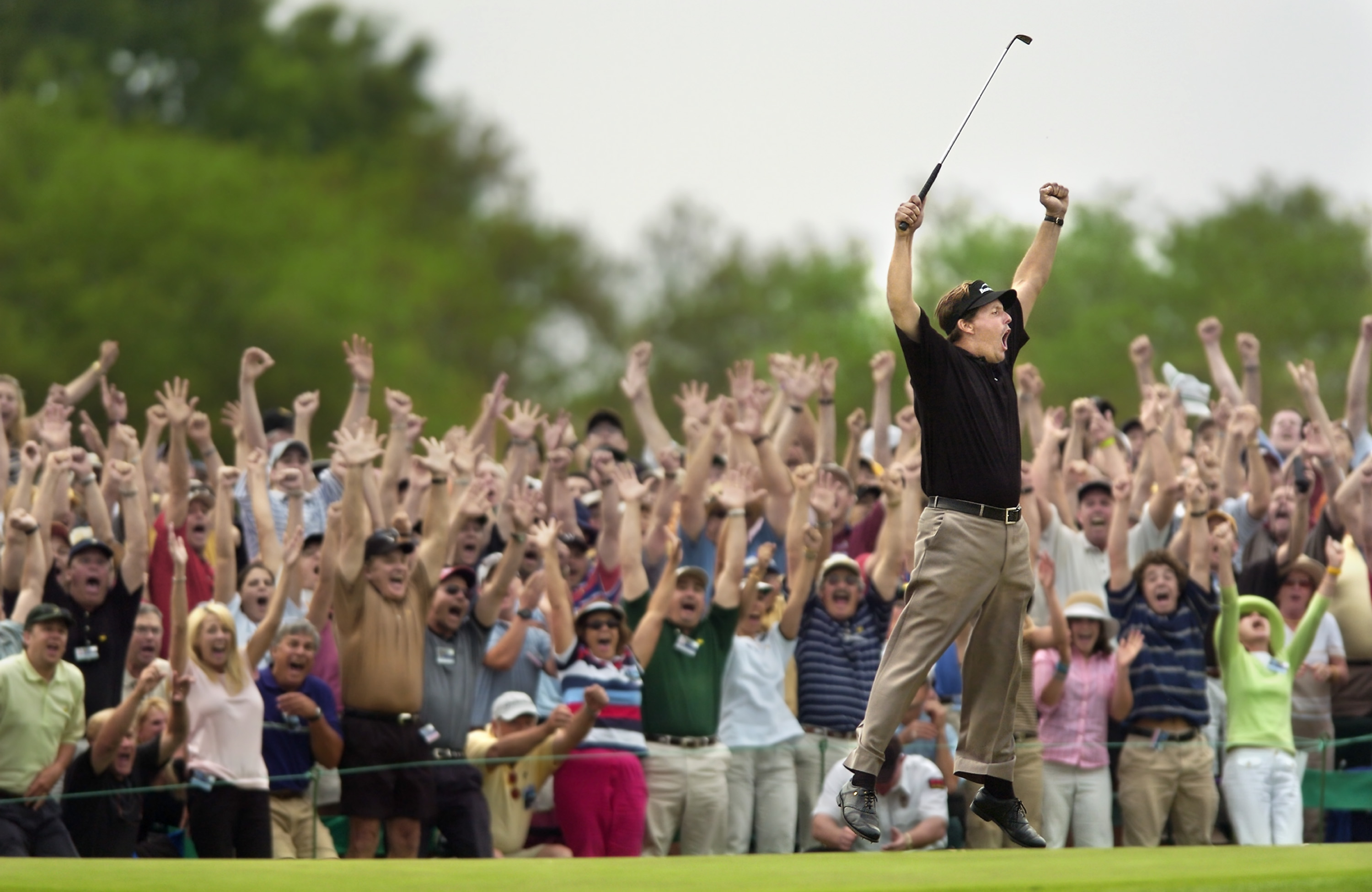 12-Masters-Leap-Phil-Mickelson